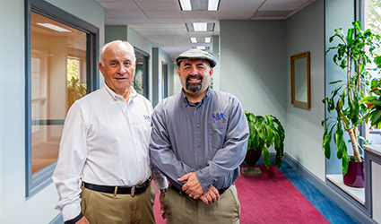 Larry and Geoff Bosley inside the offices at Liberty Place